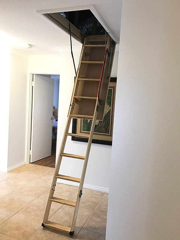 Attic Ladder Installed - Door open, Ladder extended